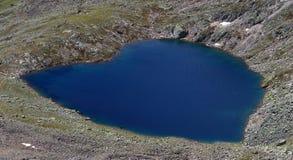 Turquoise waters of heart-shaped Gaislacher Lake on top of Mount Gaislachkogel near Sölden, Ötztal in Tyrol, Austria. stock image
