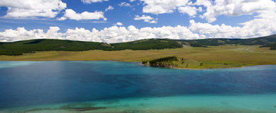 Turquoise Waters of Khovsgol Lake. Crystal clear turquoise waters of Khovsgol Lake in northern Mongolia Stock Photos