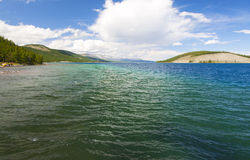 Turquoise Waters of Khovsgol Lake. Crystal clear turquoise waters of Khovsgol Lake in northern Mongolia Royalty Free Stock Photo