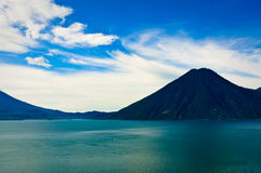 Turquoise Waters of Lake Atitlan, Guatemala. Turquoise Waters of Lake Atitlan and its Volcanoes.  The turquoise waters of Lake Atitlan, Guatemala with one of its Stock Image