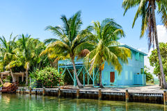 Turquoise waterside house, Placencia, Belize, Stock Photos