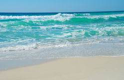 Turquoise Waves. Silky smooth beach with turqoise waves breaking at shore Stock Images
