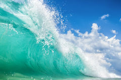 Turquoise waves against the sky Royalty Free Stock Photo