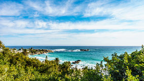 The turquoise waves of the Atlantic Ocean crashing on the shores near Camps Bay Stock Photo