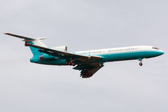 Turquoise-white airplane. Jet airplane is approaching Rwy Stock Photos