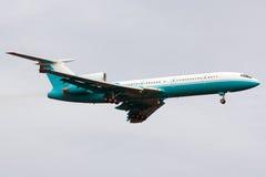 Turquoise-white airplane Stock Photos