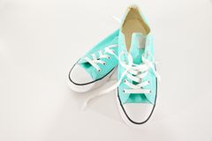Turquoise and White Canvas Sneakers on a White Background Stock Photography