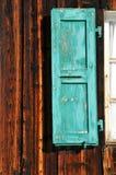 Turquoise window shutter Stock Photos
