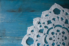 Turquoise wooden background in country style with crocheted lace doily. Turquoise wooden background in country style with white crocheted doily stock images