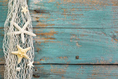 Turquoise wooden background with starfish - maritime decoration. stock photo