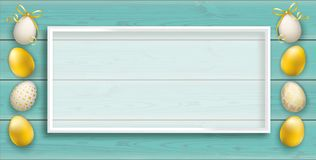 Premium Easter Eggs Turquoise Planks Header White Frame. Turquoise wooden background with the white frame and golden easter eggs Royalty Free Stock Photography