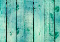 Turquoise wooden planks on direct sunlight. Flat view stock image