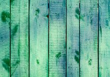 Turquoise wooden planks on direct sunlight. royalty free stock photos
