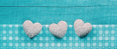 Turquoise wooden shabby chic background with white hearts on a c Stock Photos