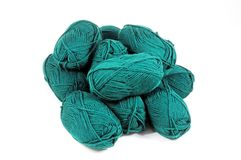 Turquoise wool. Turquoise coloured balls of wool against a white background royalty free stock image