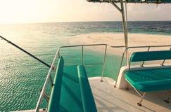 Turquoise yacht in Maldives. Sunset Stock Image