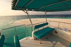 Turquoise yacht in Maldives. Sunset Royalty Free Stock Images