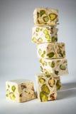 Turrón. Soft turrón cubes with pistachios Stock Photos