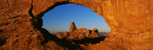 Turret Arch. This is known as Turret Arch which is in the center. It looks through what is known as the North Window. It is located in the Windows Section. This stock photography