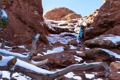 Turret Arch, Arches NP. Photographer taking pictures of Turret arch early winter with snow and ice on the red rock royalty free stock image