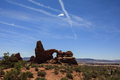 Turret Arch and Contrail, Arches National park, Utah, USA. Turret Arch is one of many arches that populate Arches National Park, Utah Stock Photos