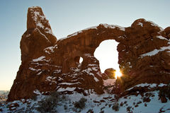 Turret Arch with emerging sun. Sun emerges between rock under Turret Arch in Arches National Park near Moab, Utah Royalty Free Stock Images