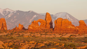 Turret Arch and La-Sal Mountains at sunset. Arches National Park, Utah royalty free stock photography