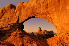 Turret Arch through North Window. Turret Arch through the North Window at sunrise in Arches National Park near Moab, Utah royalty free stock photos