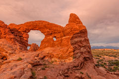 Turret Arch Sunset. Scenic turret arch in Arches National Park Utah Stock Photo