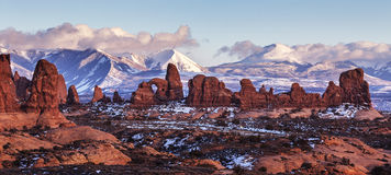 Turret Arch, Utah. Turret Arch with Snow Mountains at sunset. Arches National Park, Utah stock photos
