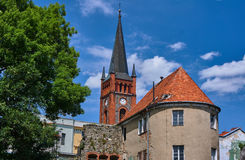 Turret and church tower with a clock Royalty Free Stock Photo