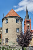 Turret and church tower with a clock Royalty Free Stock Images