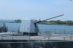 Turret containing a 5-inch gun on the deck of US Navy guided-missile destroyer USS Bainbridge. NEW YORK - MAY 26, 2016: Turret containing a 5-inch gun on the Royalty Free Stock Photography