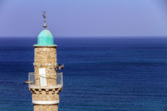 The turret of El Baher mosque in front of the mediterranean sea Royalty Free Stock Photo
