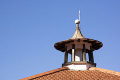 Turret Extending from Red Tiled Roof Against Blue Sky Royalty Free Stock Image