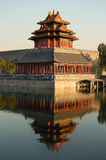 Turret, forbidden city. Turret, wall and their reflections on moat in the northwest corner of the forbidden city, Beijing China stock photo