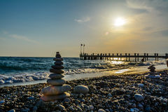 Turret pebbles with  sunset background and a bridge Royalty Free Stock Photos