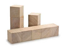 Turrets and the columns combined from wooden cubes Stock Photos