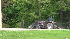 Turriff, Aberdeenshire / Scotland - July 05, 2015: Tractor smoothing the gravel of a castle path. TURRIFF, ABERDEENSHIRE SCOTLAND JULY 05, 2015 Tractor smoothing stock video