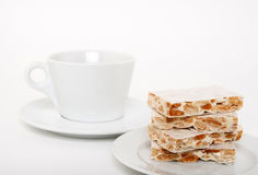 Turron, traditional Spanish dessert and a teacup Stock Images