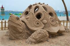 Turtle beach. Turtle shaped sandcastle in Dubai Stock Photo