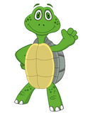 Turtle cartoon waving hand Stock Images