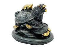 Turtle dragon stand on a pile of money vinyl sacred object Royalty Free Stock Photo