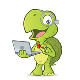 Turtle holding a laptop Royalty Free Stock Images