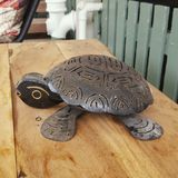 Turtle metal ornament. Black metal garden decoration Royalty Free Stock Image