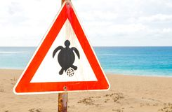 Turtle nesting season sign at the beach. Sign warning tourists of the turtle nesting season in Cape Verde stock photo