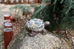 Turtle ornament on granite rock stock photos