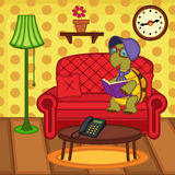 Turtle reading book on couch Stock Images