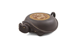 Turtle-shaped stand for ceramic teapot Royalty Free Stock Photography
