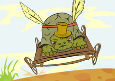 Turtle. Speeding cartoon turtle on a wooden trolley Royalty Free Stock Image